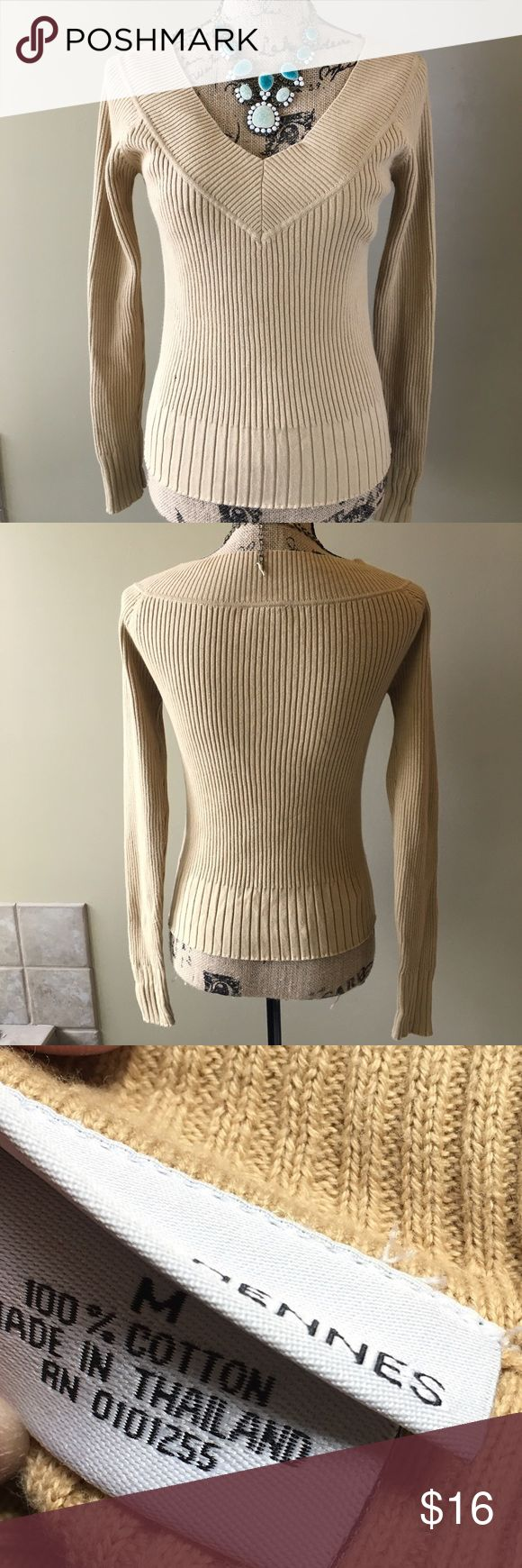 Hennessy deep v-neck ribbed top. A form fitting ribbed top with a deep v-neck. Almost perfect condition. Tiny hole on side as seen in image. Price is reflected. Add this to a bundle to save 15%. For jewelry, visit my profile for a link to shop. Hennes Sweaters V-Necks