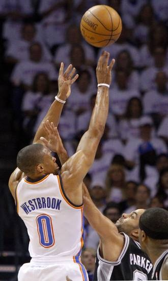 Oklahoma City's Russell Westbrook (0) shoots the ball over San Antonio's Tony Parker (9) during Game 6 of the Western Conference Finals between the Oklahoma City Thunder and the San Antonio Spurs in the NBA playoffs.