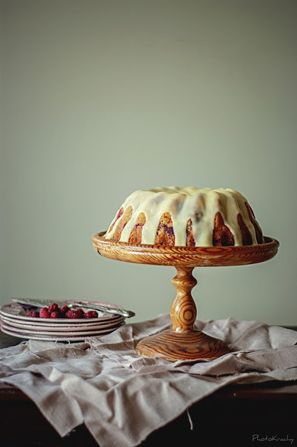yoghurt boundt cake with rasberries and white chocolate icing by Agnieszka Krach