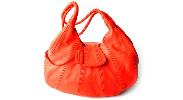 Bright orange genuine leather Thembi Bag! Hand stitched & made locally in South Africa. #leather #bag #orange