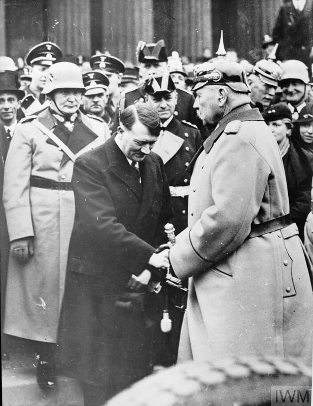 THE NAZI SEIZURE OF POWER, 1933 - 1935 Adolf Hitler greets Marshal Paul von Hindenburg, the German President, at a ceremony in Berlin in early 1934, after Hitler's appointment as Chancellor in 1933. Behind Hitler are Joseph Goebbels, Herman Goering, SS General Sepp Dietrich and Admiral...