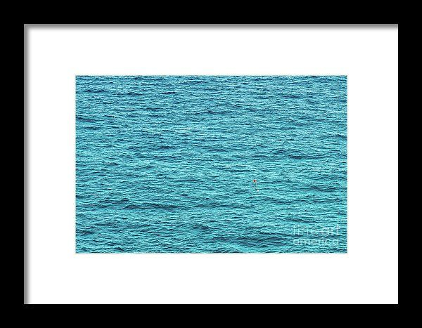 Red Life Buoy In The Middle Of The Wide Ocean Framed Print
