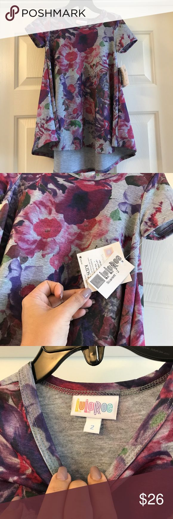 NWT Size 2 Lularoe Scarlett dress Brand new with tags Scarlett dress from Lularoe. It's the kid's version of the Carly dress. Bundle and save! LuLaRoe Dresses Casual