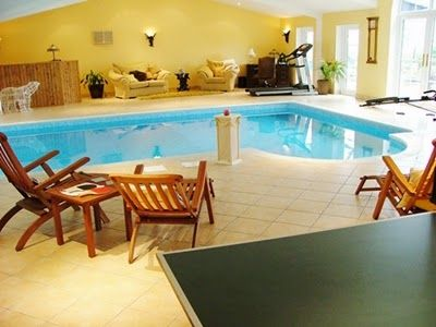 Luxurious Indoor Swimming Pool Ideas with Classic Floor Tile Designs