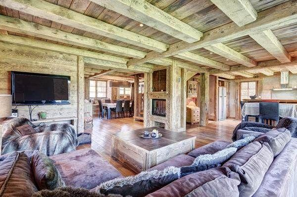 Living room like the whole mansion interior designed in wooden style. Megève, France