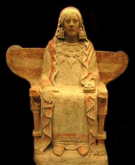 La Dama de Baza. Goddess seated on winged throne with lion-footed legs. She holds a blue-painted dove in her left hand. Strong Phoenician influences have led some to suggest that she is the goddess Tanit.   She was found in a deep funerary chamber in the Cerro del Santuario, a burial ground. The place-name means Hill of the Sanctuary,  one of many modern names identifying ancient Iberian sites as holy places. Baza (Basti), northwestern Granada.  4th century BCE.