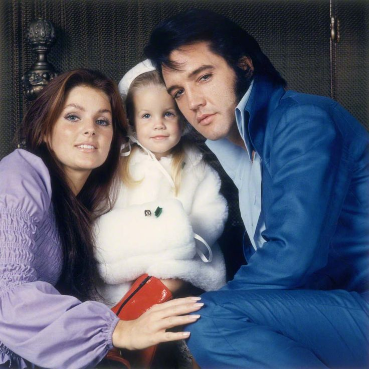 Elvis Presley, Priscilla Ann Wagner and their daughter Lisa-Marie by Frank Carroll, 1969