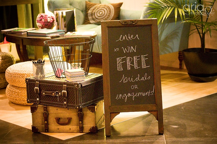 Bridal Show Booth Concept-chalkboard and giveaway idea. Coincidentally, I bought this exact same sidewalk sign for my February bridal shows!