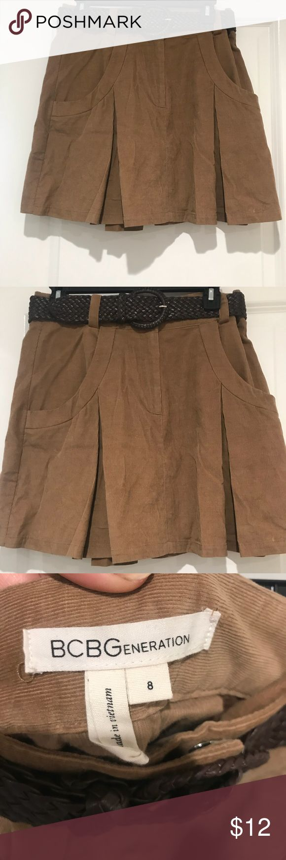 BCBG generation corduroy Kakhi colored skirt sz 8 BCBG generation khaki colored corduroy skirt in size 8! High waisted style with weaved belt and two big pockets on front of skirt! So cute for the fall and winter months with tights and boots! BCBGeneration Skirts Mini