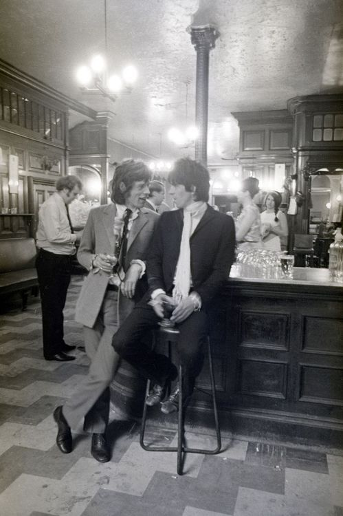 Mick Jagger and Keith Richards toasting their release from jail, 1967