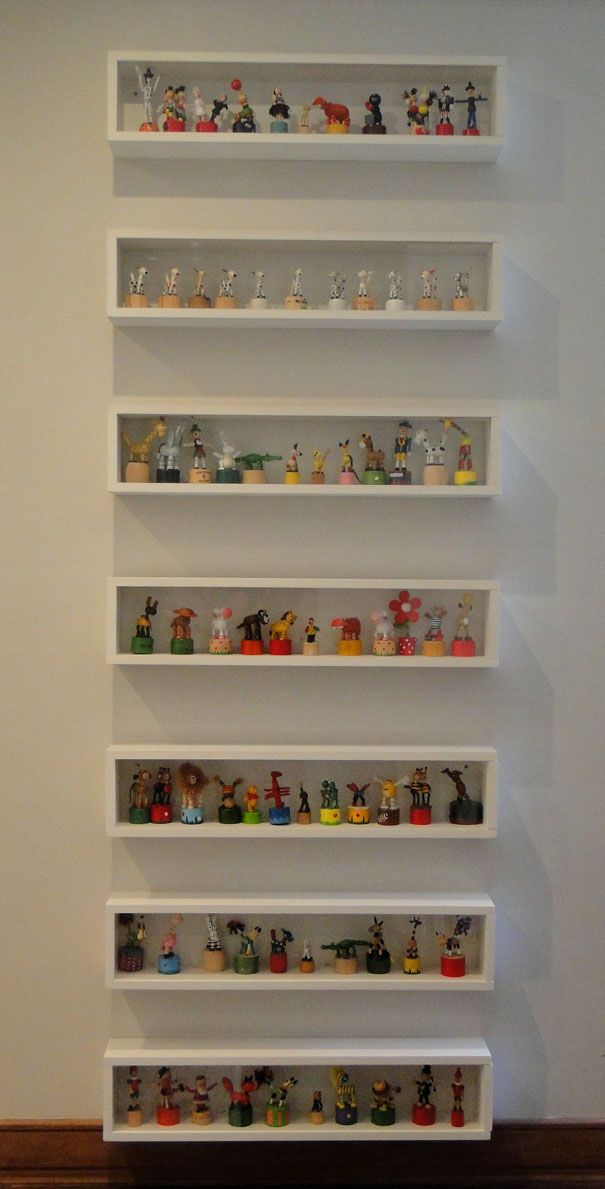 collections display ~ It looks nice every other shelf, but it would be hard for me to have that much self-control. I have to fill every space.