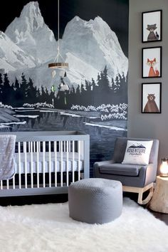 Check out this fun, modern outdoor themed nursery. The perfect boy nursery featuring a chalkboard wall with mountains, woodland animals art, and reading nook tent.