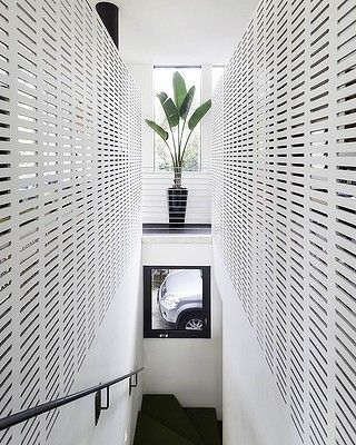 located in fitzroy north melbourne australia the house in a warehouse project was designed by splinter society the home is b