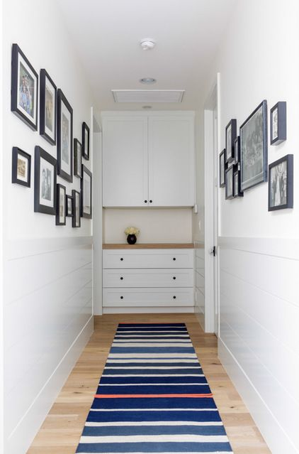 Linen storage at the end of a hall.  So much nicer than two big doors, there is a bench providing space for a bit of decoration.