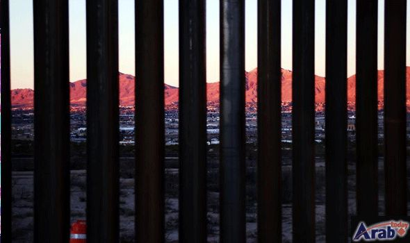View of border wall between Mexico and…
