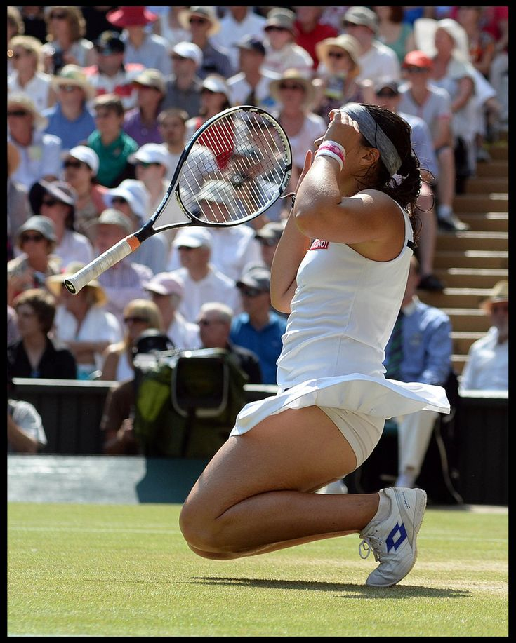 Sabine Lisicki Photos - France's Marion Bartoli reacts after winning the Wimbledon Tennis Championships 2013 in London. Marion Bartoli wins her first Grand Slam title with a dominant 6-1 6-4 victory over Sabine Lisicki in the Women's Final at the Wimbledon Tennis Championships at The All England Lawn Tennis Club. - Sabine Lisicki Photos - 988 of 2328