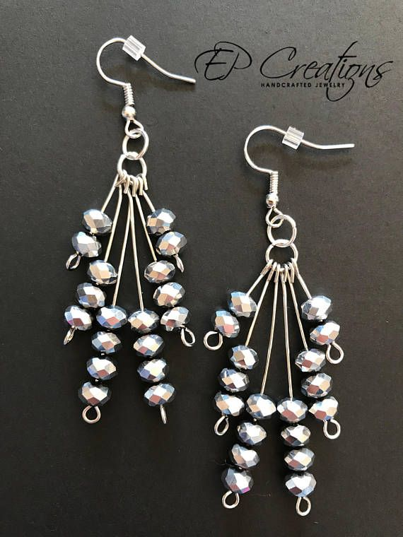 Long silver dangle earrings with silver crystal beads Elegant and delicate long silver dangle earrings with silver crystal beads. Earrings are designed to accessorize special occasion wardrobe as well as daily outfit. Earrings come with iron, nickel-free ear-wire, silver colored.