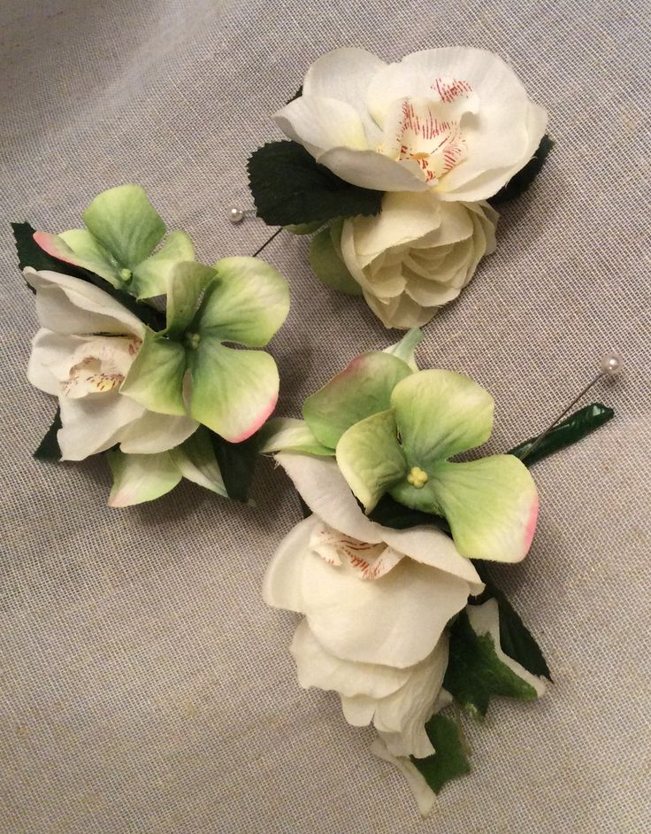 Orchid and hydrangea corsages by Cathey's flowers