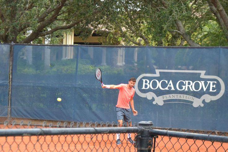 Tennis Pro, Grigor Dimitrov, testing racquets on the Boca Grove red clay stadium course.