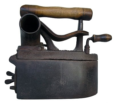 charcoal iron, fill it with charcoal to heat it