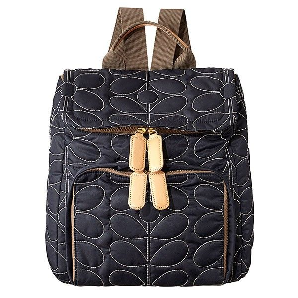 Quilted backpack by Orla Kiely.  New for Spring Summer 2014 in midnight blue with leather trims.  Never thought a backpack could look so good.  The carry handle is a fantastic touch.