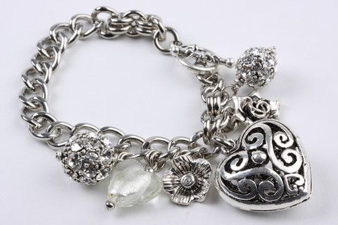 Hearts and Charms Bracelet: Classic and very feminine, these studs are great for adding a timeless sophistication to any outfit. Grey acrylic pearl stud with real rhodium finish. $79.90