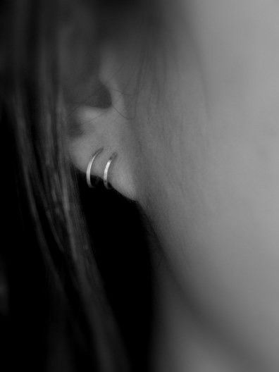 Two-In-One Hoop. This hoop is intended for people with singular, normally pierced ear holes, but it can also work for two holes, too. Just thread it from one of the ends into your left ear hole until it touches the front of your earlobe. Ta-da! Now you have two hoops in your ear.