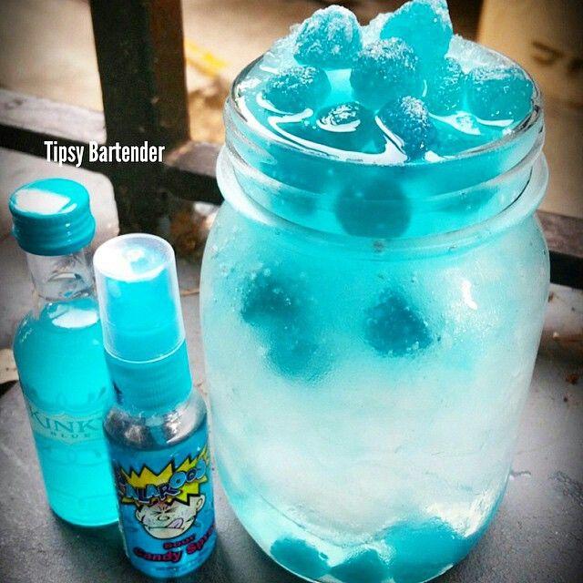 KINKY SOUR PATCH Bottom Layer: 1 oz. (30ml) Bacardi Razz 4 oz. (120ml) Smirnoff Ice 3 Sprays of Sour Candy Spray Stir with Ice  Blue Layer: 2 oz. (60ml) Kinky Blue 1 oz. (30ml) Sour Raspberry Blue Juice 3 Sprays of Sour Candy Original Blend with Ice  Add Blue Raspberry Sour Patch Candy