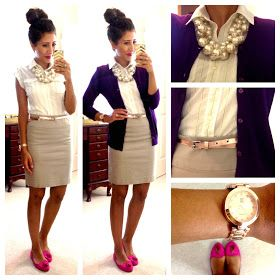 White button up, tucked into a cream/light brown skirt, metallic belt on skirt, large pearl cluster necklace, deep purple cardigan, pink pumps, work