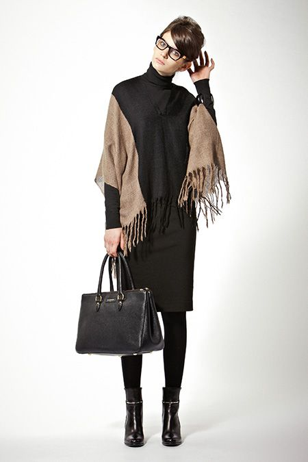 Black turtleneck, black and camel poncho, black pencil skirt, black tights, black ankle boots