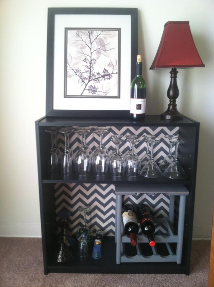 $15 Walmart bookshelf. Add your favorite fabric to the back.Instant dry bar!