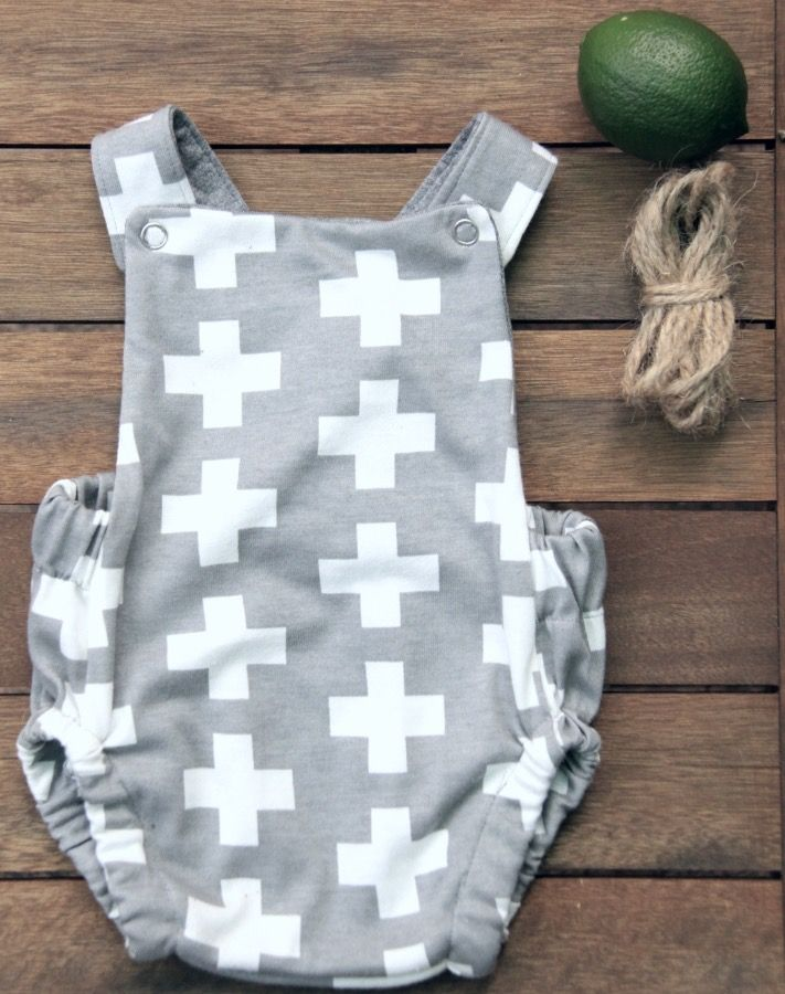 100% brushed cotton jersey. Adjustable straps to modify as your little one grows. Available in majority grey with white crosses or majority white...