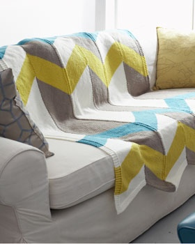 """Featuring bold zig-zag stripes of pop color, this chic chevron blanket is a stylish addition to any home. Shown in Bernat Super Value."""