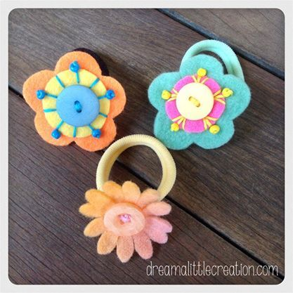 Felt flower hair ties, two flowers and one daisy. Under $10 Market Night Tuesday 8th April, 2014