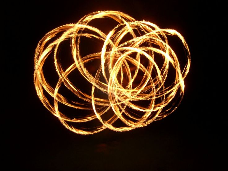 Fire Poi, which is performed on the Midway before patrons get to the ship.