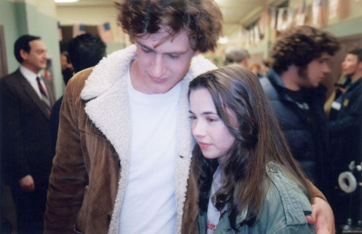 """Linda Cardellini and Jason Segel on the last day of filming (2000). Judd Apatow: """"I loved writing for Jason. That's what I felt like in high school. I felt goofy and ambitious and not sure if I had any talent, and I would be in love with these women and didn't actually know if they liked me that much . . . Jason really captured that desperation I felt when I was younger."""""""