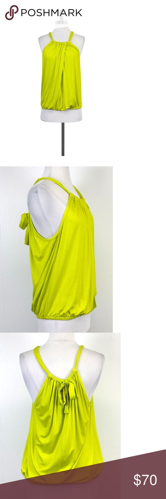 "Trina Turk- Neon Yellow Sleeveless Top Sz P This neon yellow top is perfect for summer. Wear it with a pleated skirt and sandals for a stylish casual outfit! Size Petite Body 90% Viscose 10% Elastane Made in the USA Slips on Elastic hem Shoulder to Hem 27.5"" Trina Turk embodies a pretty, flirty and fun style. Her collections are perfect for the office or a weekend getaway. This particular designer likes to focus on the perfect fit and feminine colors and shapes.Her garments are popular in…"