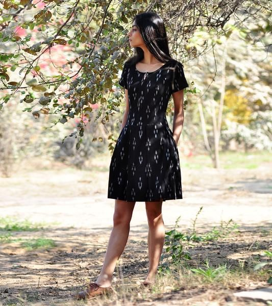 Crafted in handloomikat,this dress is fun and stylish and a must have in your summer wardrobe. The design features round neck, short, fitted torso and a plea