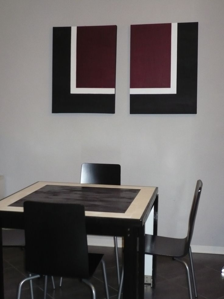The wall in the dining room was very empty. I did these canvas. The dark red is the only colour, the main theme of the apartment is just black and white