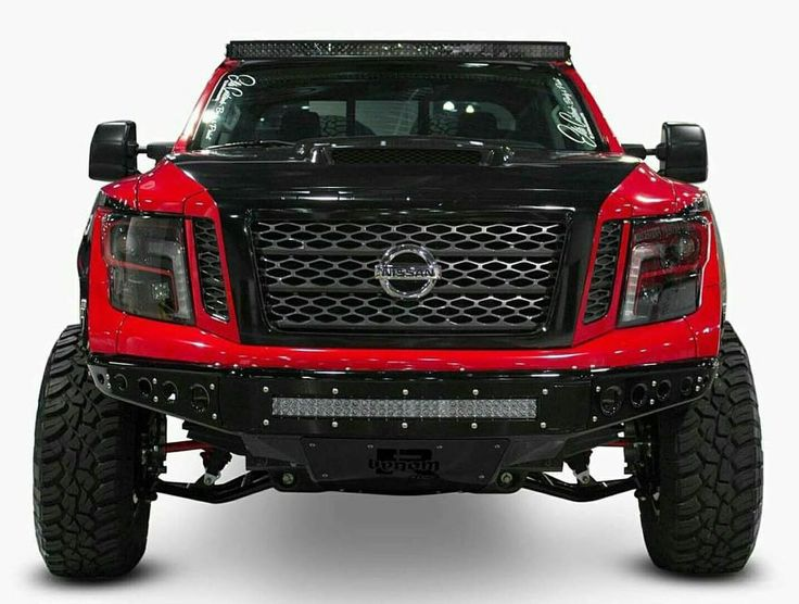 """#mulpix #frontendfriday Our Nissan Titan XD built by @elitecustoms775. Lookin sick with those @addoffroad bumpers and @rigidindustries lights. Has @ivdsuspension Coilovers and bypass. 37"""" @general_tire wrapped around @kmcwheels XD Machete beadlocks. Custom headlights by @plainansimple1. Wrapped by @chuckycourty @ecdcustoms. @beardseats inside. @mcneilracinginc fiberglass with @rksport hood. #kegmedia #elitecustoms #nissan #titan #titanXD #cummins #diesel #prerunner"""