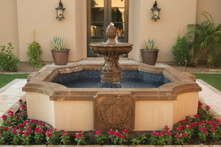 Spanish fountain planter lights next to door for Mexican style outdoor fountains
