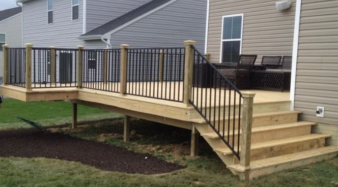 20 X20 Pressure Treated Wood Deck With A 6 X6 Bump Out For Your Grill Added Cast Iron Railing For A Unique Look If Y Treated Wood Deck Porch Design Wood Deck