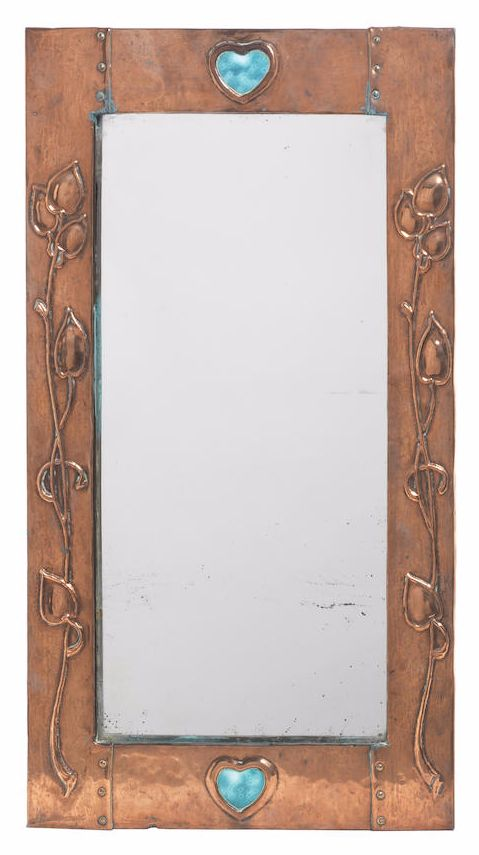 English Arts & Crafts copper wall mirror, early 20th century, decorated with two enamel hearts and repoussé foliage.