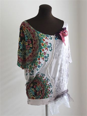 One of a kind tattered bohemian tunic top, an upcycled shabby rustic wearable art shirt featuring flower print, cream base and tattered neckline details. Has cream lace and dusky tulle inserts and embellishments at the hipline.A repurposed recycled tunic. Soft colorful jersey top has just above elbow length sleeves and neckline details in purple jersey, terracotta silk and turquoise and black jersey. You may want a camisole under this one at the shoulders. Great country weekend style for…