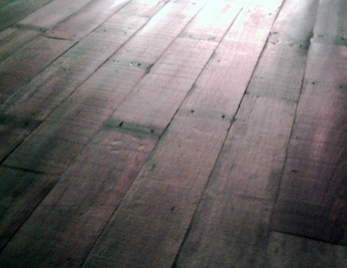 Grey stained floorboards