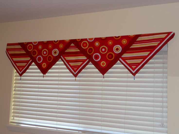Walmart bandanas used as a window topper in my guest bedroom.  String of beads at the point of each.