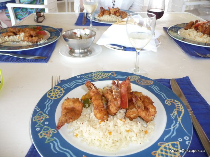 Try coconut shrimp with a glass of white wine.