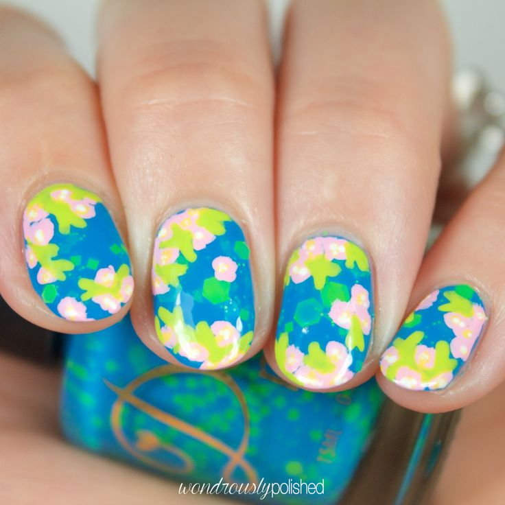 Beautiful hand painted flowers by Wondrously Polished over Delush Polish's Turn Over a New Reef