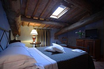 A typically Tuscan room at Villa Curina, a renovated village of farmhouses that dates back to the 16th century. http://bit.ly/1DqjRd9