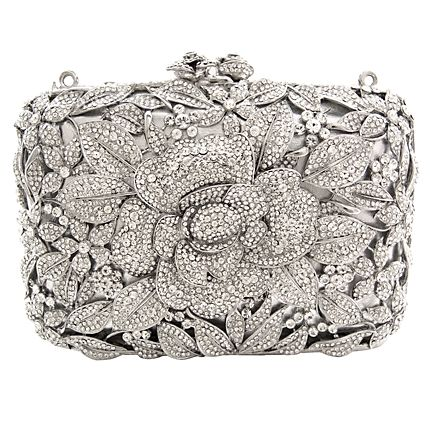The classy flower new hard clutch is perfect for that special occasion or for a night on the town.  Featuring Swarovski crystal, they come with a shoulder chain and the famous Butler & Wilson edge